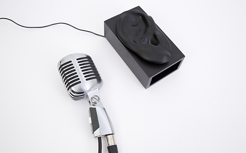 A Shure 55 microphone is connected to a computer's sound card and instrumented with a custom button.